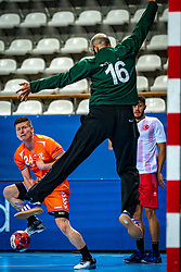 The Dutch handball player Jeffrey Boomhouwer, Coskun Goktepe in action during the European Championship qualifying match against Turkey in the Topsport Center Almere.