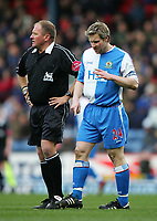 Photo. Andrew Unwin.<br /> Blackburn Rovers v Norwich, Barclays Premiership, Ewood Park, Blackburn 12/02/2005.<br /> Bloods runs down the face Blackburn's captain, Andy Todd (R), after he sustains a cut above his eye.
