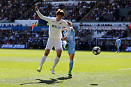 Ki Sung-Yueng of Swansea city is challenged by Joe Allen of Stoke city. Premier league match, Swansea city v Stoke City at the Liberty Stadium in Swansea, South Wales on Saturday 22nd April 2017.<br /> pic by Andrew Orchard, Andrew Orchard sports photography.