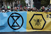 Extinction Rebellion disruption begins as the activists block 12 sites around Westminster on 7th October 2019 in London, England, United Kingdom. Extinction Rebellion is a climate change group started in 2018 and has gained a huge following of people committed to peaceful protests. These protests are highlighting that the government is not doing enough to avoid catastrophic climate change and to demand the government take radical action to save the planet.