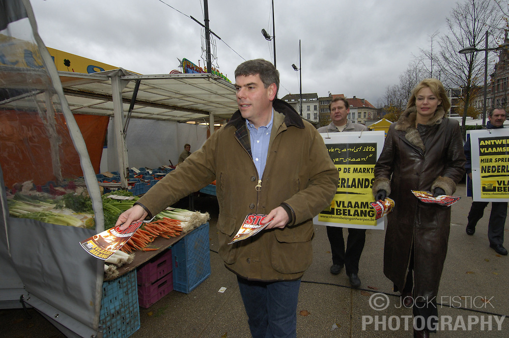 ANTWERP, BELGIUM - NOV-25-2005 -Filip Dewinter and Anke van Dermeersch of the Vlaams Belang , the Flemish extreme right political party, canvassed the market on Sint-Jansplien, in an immigrant neighborhood of Antwerp, spreading their message that Dutch should be the major language used in shops and markets in Antwerp. (PHOTO © JOCK FISTICK)<br />