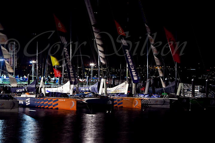 Volvo Open 70 boats docked at the Volvo Ocean Race port, at Fan Pier, the night before the start of Leg 7.