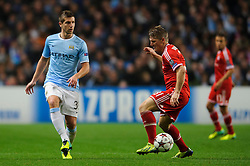 Man City Defender Matija Nastasic (SRB) is challenged by Bayern Midfielder Bastian Schweinsteiger (GER) during the second half of the match - Photo mandatory by-line: Rogan Thomson/JMP - Tel: Mobile: 07966 386802 - 02/10/2013 - SPORT - FOOTBALL - Etihad Stadium, Manchester - Manchester City v Bayern Munich - UEFA Champions League Group D.