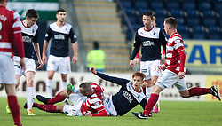 Hamilton's Darian Mackinnon tackles Falkirk's Scott Shepherd.<br /> Falkirk 1 v 1 Hamilton, Scottish Premiership play-off semi-final first leg, played 13/5/2014 at the Falkirk Stadium.
