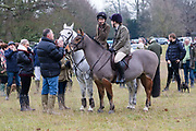 Horses and riders arrive for the traditional Chiddingfold, Leconfield and Cowdray Boxing Day Hunt, which sets off from the kennels at Petworth House in Petworth Park, West Sussex, UK on December 26, 2018