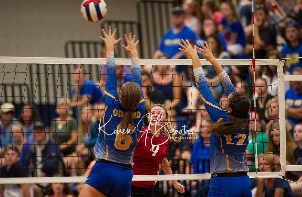 Laconia's Maddy Todd spikes the ball past blockers Lexi Boisvert and Abby Warren during NHIAA Division II Volleyball on Saturday evening.  (Karen Bobotas/for the Laconia Daily Sun)
