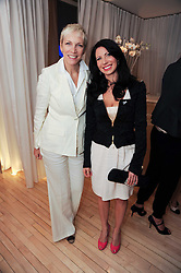 Left to right, ANNIE LENNOX and CHLOE BAIRD-MURRAY at a private dinner for the White Ribbon Alliance's Global Dinner Party Campaign, at Agua, Sanderson Hotel, Berners Street, London on 4th March 2010.