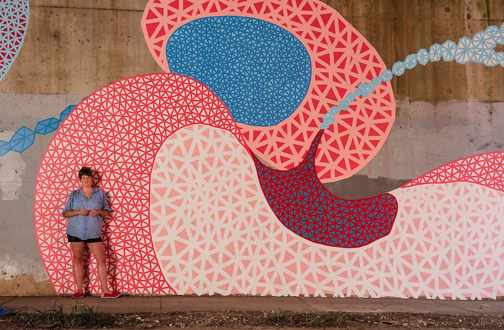 Molly Rose Freeman, a street artist, in front of her giant kidney mural in the Edgewood neighborhood, Atlanta.
