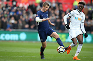 Eric Dier of Tottenham Hotspur goes past Tammy Abraham of Swansea city ®. The Emirates FA Cup, quarter-final match, Swansea city v Tottenham Hotspur at the Liberty Stadium in Swansea, South Wales on Saturday 17th March 2018.<br /> pic by  Andrew Orchard, Andrew Orchard sports photography.