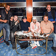 Sitting Shane Lynch, Tamer Hassan, ManLikeHaks and Dapper Laughs attend the Driving holiday experience hosts yacht party at The Sunborn Yacht, Royal Victoria Dock on 31 May 2019, London, UK.
