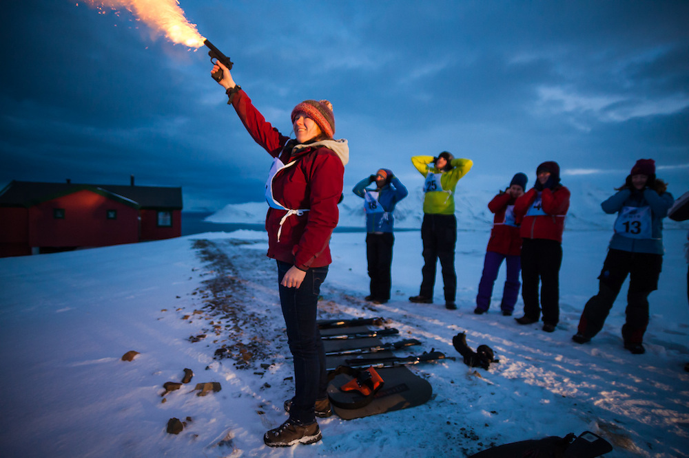 Anouk Vlug fires a flare gun as other UNIS students cover their ears at a shooting range outside Longyearbyen, Svalbard. The university center's basic safety training focuses on polar bear encounters and snowmobile driving.