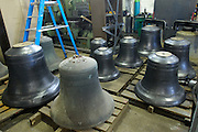 UK - Friday, Nov 07 2008:  Seven of the eight bells recently cast and destined for St Mary's Church on the Isles of Scilly, stand on the floor of Nicholson Engineering.  The bells were cast at Whitechapel Bell Foundry, London, and were photographed at Nicholson Engineering in Bridport, Dorset. Nicholson are building the frame to hold the bells. (Photo by Peter Horrell / http://www.peterhorrell.com)