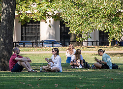 © Licensed to London News Pictures. 22/09/2020. London, UK. Office workers in St James's Park enjoy the last rays of sun before a break in the weather tomorrow with temperatures down by 10c with wind and rain forecast. Prime Minister Boris Johnson has announced further tougher Covid restrictions with a 10pm curfew on pubs and restaurants and a £200 fine for not wearing a mask and for breaking the rule of six as a spike in coronavirus rates continues across the country. Photo credit: Alex Lentati/LNP