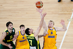 Darjus Lavrinovic #7 of Lithuania and Kyryl Natyazhko #10 of Ukraine jumping for the first ball in the game during basketball match between National teams of Ukraina and Lithuania in 2nd Round at Day 12 of Eurobasket 2013 on September 14, 2013 in SRC Stozice, Ljubljana, Slovenia. (Photo By Urban Urbanc / Sportida)