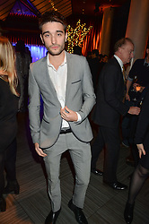 TOM PARKER at the fourth annual Fayre of St James's charity Christmas concert hosted by the Quintessentially Foundation and The Crown Estate in partnership with Deutsche Asset & Wealth Management held at  St James's Church, 197 Piccadilly, London followed by a party at Quaglino's 16 Bury Street, London on 24th November 2015.