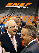 Berkshire Hathaway CEO Warren Buffett (L) talks with BNSF CEO Matt Rose before the Berkshire Hathaway annual meeting in Omaha, Nebraska, U.S. May 6, 2017. REUTERS/Rick Wilking