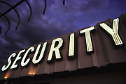 Security sign at dusk on top of a building in downtown Denver, Colorado. USA.