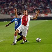NLD/Amsterdam/20060823 - Ajax - FC Kopenhagen, duel tussen Razak Pimpong en John heitinga