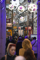 © London News Pictures. 21/12/2013 . London, UK.  Christmas shoppers on St Christopher's Way, central London on 21 December, the busiest shopping day of the year. Photo credit : Ben Cawthra/LNP