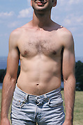 Man standing in the sun without a T-shirt on