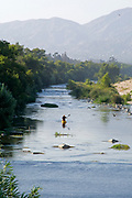 "Day 2 of the Los Angeles River Expedition 2008. Organized by LA river kayaker and LaLa Times publisher George Wolfe, boaters embarked on a 52-mile exploration of the full river, from its source (Canoga Park) to its estuary (Long Beach). Deemed not to be a ""traditional navigable water"" by the Army Corps of Engineers — and therefore not worthy of clean water standards, the Expedition's purpose is to prove it is navigable. Glendale Narrows, Los Angeles County, California, USA."