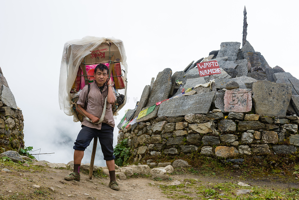 A porter carries 50 kg in Tengboche, Nepal. Photo © robertvansluis.com