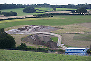 Earth is piled up at the site of a ventilation shaft for the Chiltern Tunnel on the HS2 high-speed rail link on 18th July 2020 in Chalfont St Giles, United Kingdom. The Department for Transport approved the issuing of Notices to Proceed by HS2 Ltd to the four Main Works Civils Contractors MWCC working on the £106bn rail project in April 2020.