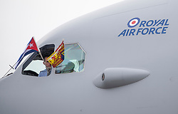 Flags are flown from the cockpit as the Prince of Wales and the Duchess of Cornwall arrive at Jose Marti International Airport in Havana, Cuba for the start of an historic visit which will see them celebrate cultural ties between the UK and the Communist state.
