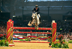Great Britain's William Funnell riding Billy McCain competes in the Christmas Masters during day seven of the London International Horse Show at London Olympia.