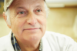 Portrait photograph of older butcher reflecting on life