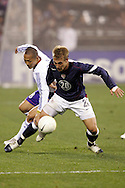 10 February 2006: Taylor Twellman (20), of the U.S., is challenged by Japan's Shinji Ono (l). The United States Men's National Team defeated Japan 3-2 at SBC Park in San Francisco, California in an International Friendly soccer match.