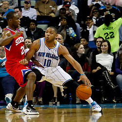 January 4, 2012; New Orleans, LA, USA; New Orleans Hornets shooting guard Eric Gordon (10) is defended by Philadelphia 76ers guard Jodie Meeks (20) during the second half of a game at the New Orleans Arena. The 76ers defeated the Hornets 101-93.  Mandatory Credit: Derick E. Hingle-US PRESSWIRE
