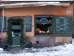Exterior of traditional cafe in Gamla Stan old town district in winter in Stockholm Sweden