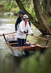 © Licensed to London News Pictures. 04/06/2021. Oxford, UK. Members of the public are seen rowing a barge on the River Cherwell past Oxford Botanic Gardens, in central Oxford, England, on a wet and overcast day. The UK is experiencing damp and overcast conditions following a week of annual high temperatures. Photo credit: Ben Cawthra/LNP
