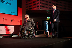 © Licensed to London News Pictures. 03/03/2016London UK. Chancellor George Osborne walks on to the stage behind German Federal Minister of Finance, Wolfgang Schauble at The British Chamber of Commerce Annual Conference at The QE ll Conference Centre, Westminster.<br /> Photo credit : Simon Jacobs/LNP