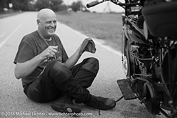 Steve Simpson working on his 1928 Harley-Davidson JD on the side of the road during Stage 2 of the Motorcycle Cannonball Cross-Country Endurance Run, which on this day ran from Lake City, FL to Columbus, GA., USA. Saturday, September 6, 2014.  Photography ©2014 Michael Lichter.