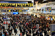 Concourse crowded with passengers at Liverpool Street station, London, England, UK