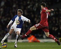 Photo: Jonathan Butler.<br />Blackburn Rovers v Liverpool. The Barclays Premiership. 26/12/2006.<br />Tugay of Blackburn avoids the incoming tackler Xabi Alonso of Liverpool.