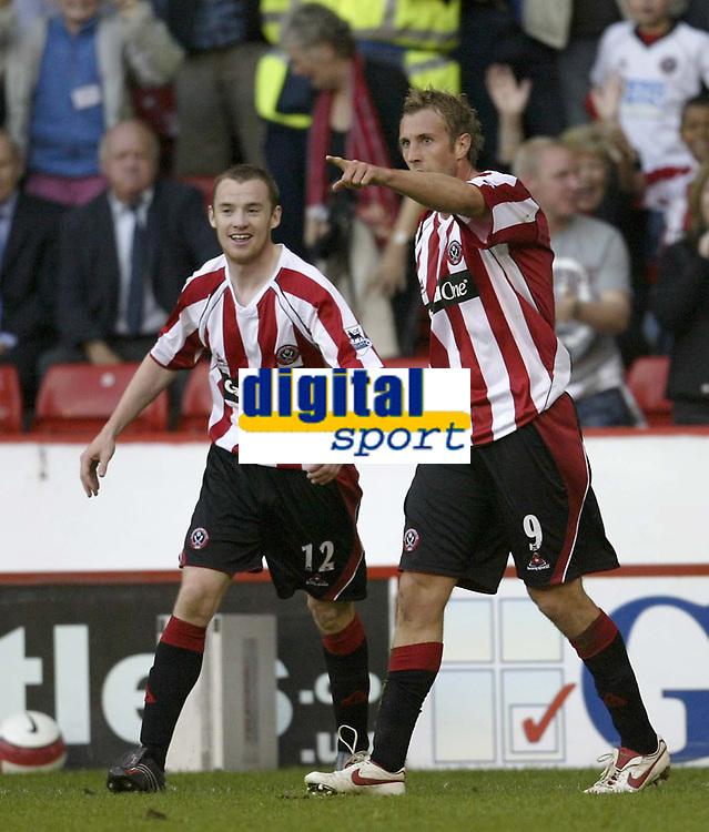 Photo: Aidan Ellis.<br /> Sheffield United v Middlesbrough. The Barclays Premiership. 30/09/2006.<br /> Sheffield's Rob Hulse celebrates hisd goal with Alan Quinn