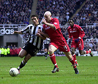 Photo. Glyn Thomas.<br /> Newcastle United v Middlesbrough. Premiership.<br /> St James' Park, Newcastle. 21/02/2004.<br /> Newcastle's Laurent Robert (L) battles for the ball with Danny Mills while Ugo Ehiogu (R) looks on.