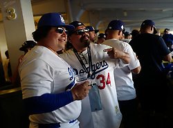 October 25, 2017 - Los Angeles, California, U.S. - Martin Flores of Los Alamitos, left, dressed as former Los Angeles Dodgers great Fernando Valenzuela poses for pictures prior to game two of a World Series baseball game against the Houston Astros at Dodger Stadium on Wednesday, Oct. 25, 2017 in Los Angeles. (Photo by Keith Birmingham, Pasadena Star-News/SCNG) (Credit Image: © San Gabriel Valley Tribune via ZUMA Wire)