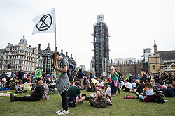 London, UK. 23rd April 2019. Climate change activists from Extinction Rebellion attending an assembly in Parliament Square write letters to their Members of Parliament requesting a meeting to discuss the issue of climate change. Activists later tried to deliver their letters to Parliament, but all but ten were prevented from doing so by the Metropolitan Police.