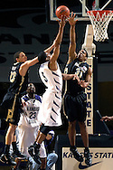 Colorado forward Jermyl Jackson-Wilson (31) blocks Kansas State guard Clent Stewart's (5) shot, as Buffalo teammate Richard Roby (23) defends on the play in the first half at Bramlage Coliseum in Manhattan, Kansas, February 10, 2007.  K-State defeated Colorado 78-59.