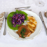 Roast pork with plums <br /> Serves 5 <br /> <br /> Ingredients: 1Kg clear fillet pork <br /> 5 dried plums from our garden<br /> ¼ teaspoon salt<br /> ¼ teaspoon pepper <br /> 1 teaspoon English herbs ready-mix <br /> <br /> <br /> Preparation :<br /> 1.Make a hole in the pork and stuff the plums<br /> 2.Fry it for a little while so the juice will stay in the meat<br /> 3.Rub the meat with the herbs the salt and the pepper and wrap it in aluminium foil<br /> 4.Put in a tray and roast for 1¼ hr at 200º <br /> <br /> <br /> Baked potatoes <br /> Serves 5 <br /> <br /> Ingredients: 10 potatoes <br /> salt<br /> ¼ teaspoon pepper <br /> 3 garlic cloves <br /> <br /> <br /> Preparation :<br /> 1.Cut the potatoes in quarters <br /> 2.Boil the potatoes in salted water for 5 mins <br /> 3.Place the potatoes in a tray and sprinkle the salt the pepper and grinded garlic<br /> 4.Bake for 40mins at 180º<br /> <br /> <br /> Boiled red cabbage <br /> Serves 5 <br /> <br /> Ingredients: ½Kg red cabbage<br /> ¼ teaspoon salt<br /> ¼ teaspoon black pepper <br /> The juice of one lemon<br /> 1 apple <br /> 1 cup sultanas <br /> <br /> <br /> Preparation :<br /> 1.Shred the cabbage <br /> 2.Boil the cabbage for 5mins <br /> 3.Let it cool down<br /> 4.Grind the apple<br /> 5.Mix the cabbage with the other ingredients