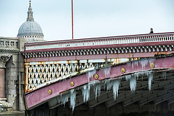 © Licensed to London News Pictures. 14/02/2021. LONDON, UK.  Icicles hang below Blackfriars Bridge as the cold snap starts to come to an end.  The forecast for the capital is for warmer temperatures next week.  Photo credit: Stephen Chung/LNP