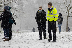 © Licensed to London News Pictures. 24/01/2021. London, UK. Police officers patrol in a snowy Greenwich park in South East London. Snow is expected for large parts of the UK and a yellow weather warning is in place in parts of England. Photo credit: George Cracknell Wright/LNP