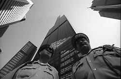 11 Sept 01. Sears Tower, Chicago, Illinois.<br /> 10.30am. Police officers stand guard beneath the Sears Tower, the USA's tallest skyscraper following its evacuation the morning of 9-11.  At this time 3 planes were still unaccounted for and it was assumed that the Sears Tower could be a potential target for radical Islamic Al Qaeda terrorists who had already flown planes into the World Trade Center and the Pentagon. <br /> Photo credit©; Charlie Varley/varleypix.com.