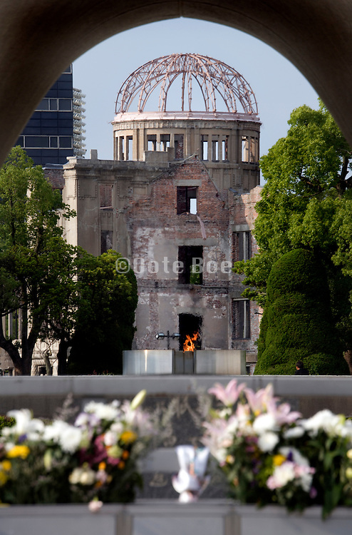 A-bomb Dome through cenotaph in Peace Park, Hiroshima, Japan