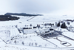 Dalwhinnie, Scotland, UK. 6 May 2021. Aerial view of snow covered landscape in the high altitude Drumochter Pass at Dalwhinnie in the Scottish highlands. Pic; Dalwhinnie scotch whisky distillery in a snow covered landscape.  Iain Masterton/Alamy Live News