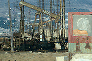 Baku, Azerbaijan, April 1999.&#xD;Communist symbols at dilapidated Soviet era on-shore state oil fields. The fields still produce, and poor sections of the population live in run-down homes in the area.&#xD;&#xD;&#xD;&#xD;&#xD;&#xD;&#xD;&#xD;&#xD;&#xD;&#xD;<br />